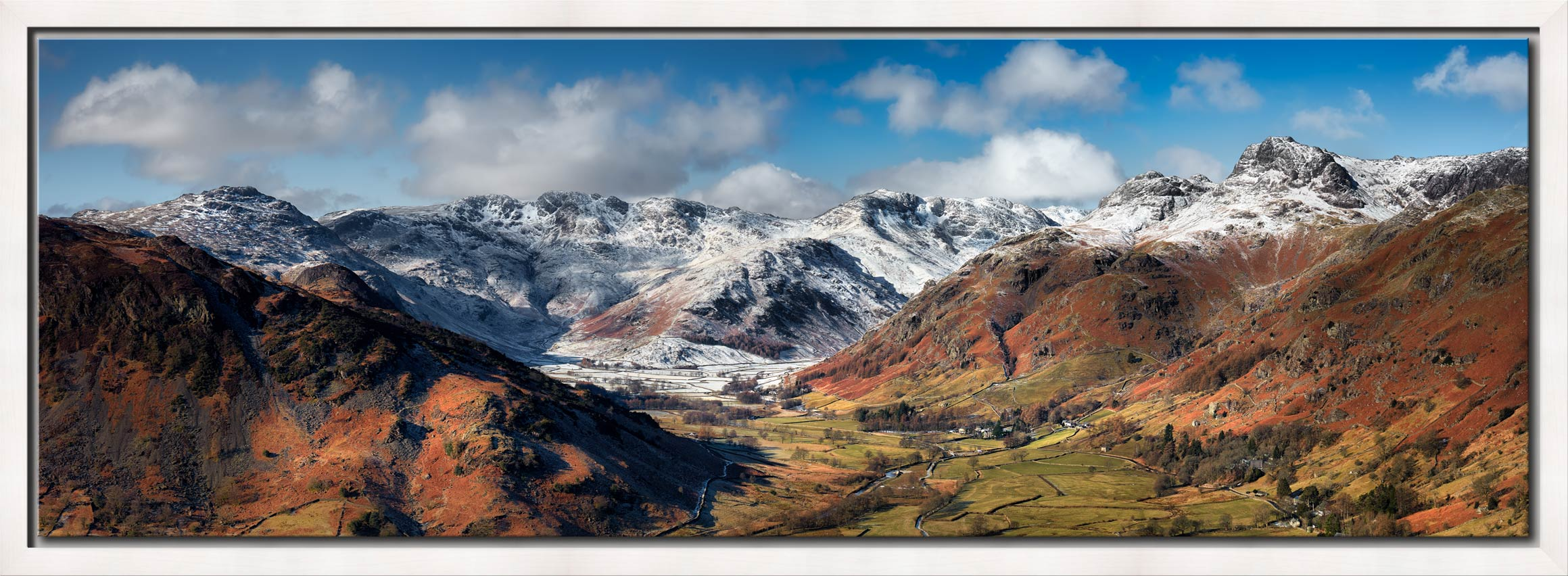 View down the Great Langdale Valley to the snow cover Crinkle Crags and Langdale Pikes - White Maple floater frame with acrylic glazing on Wall