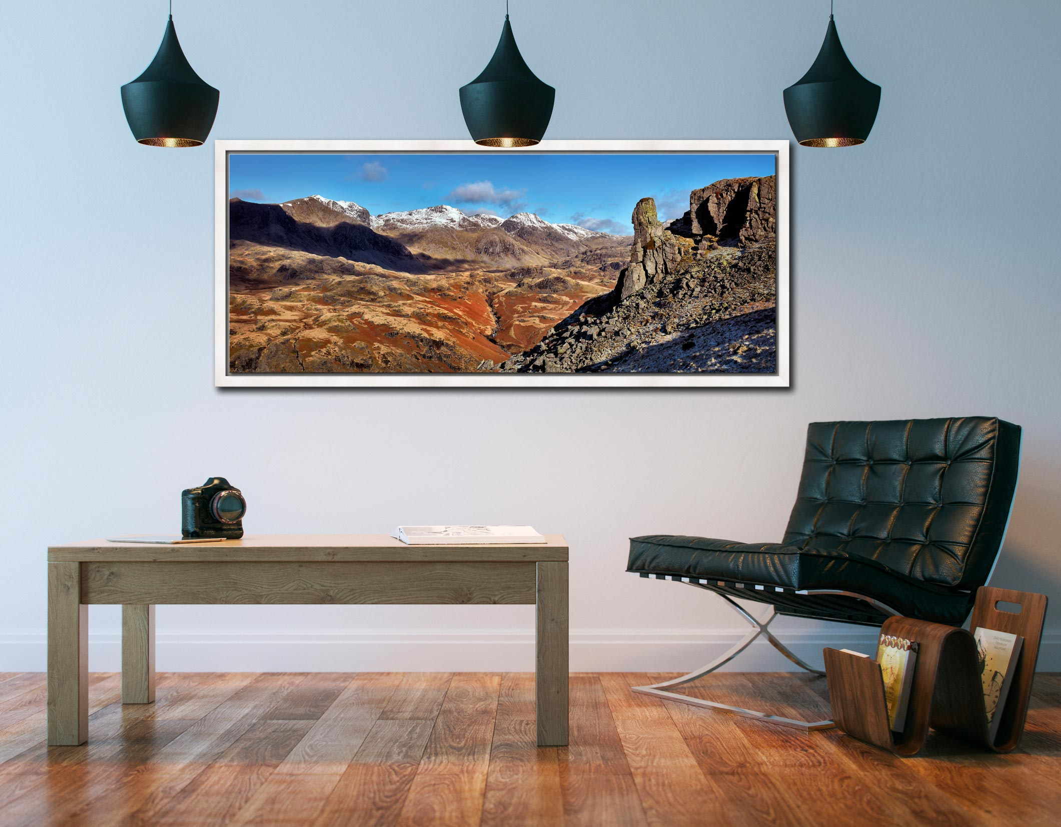 The rock needle in Eskdale, Cumbria. With the snow capped Scafell mountain range in the background - White Maple floater frame with acrylic glazing on Wall