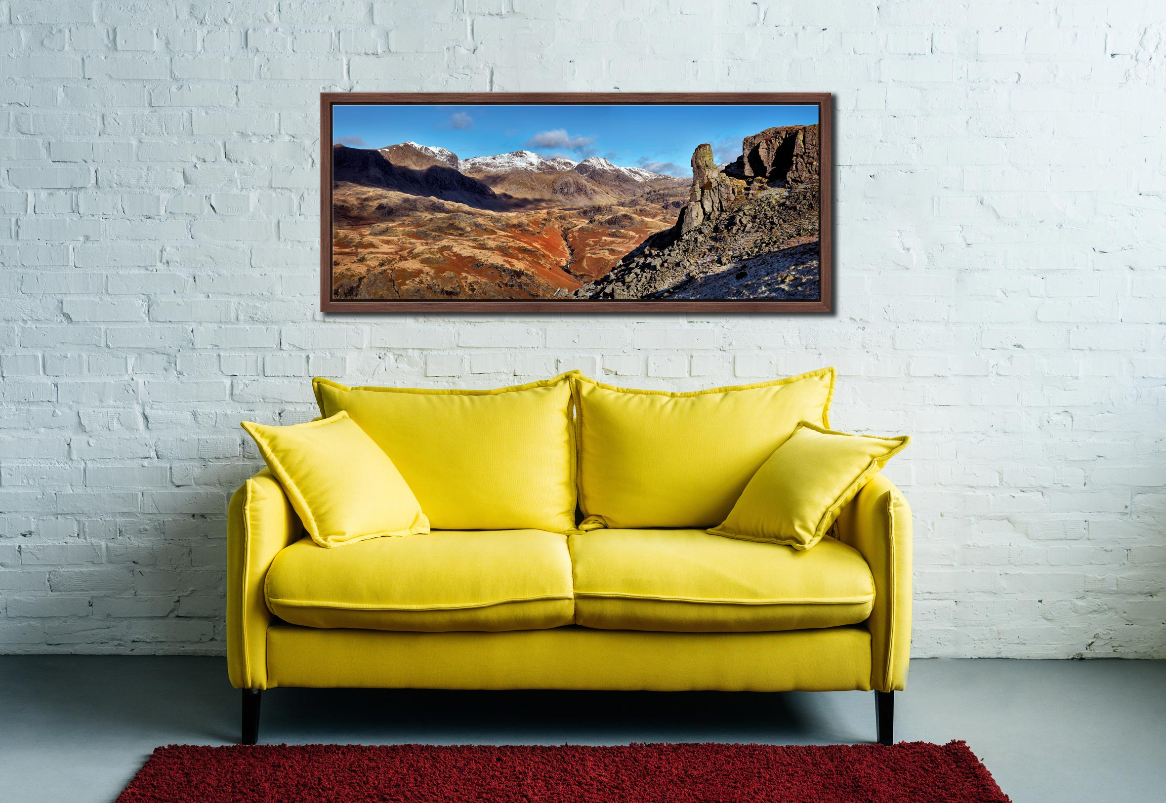 The rock needle in Eskdale, Cumbria. With the snow capped Scafell mountain range in the background - Walnut floater frame with acrylic glazing on Wall