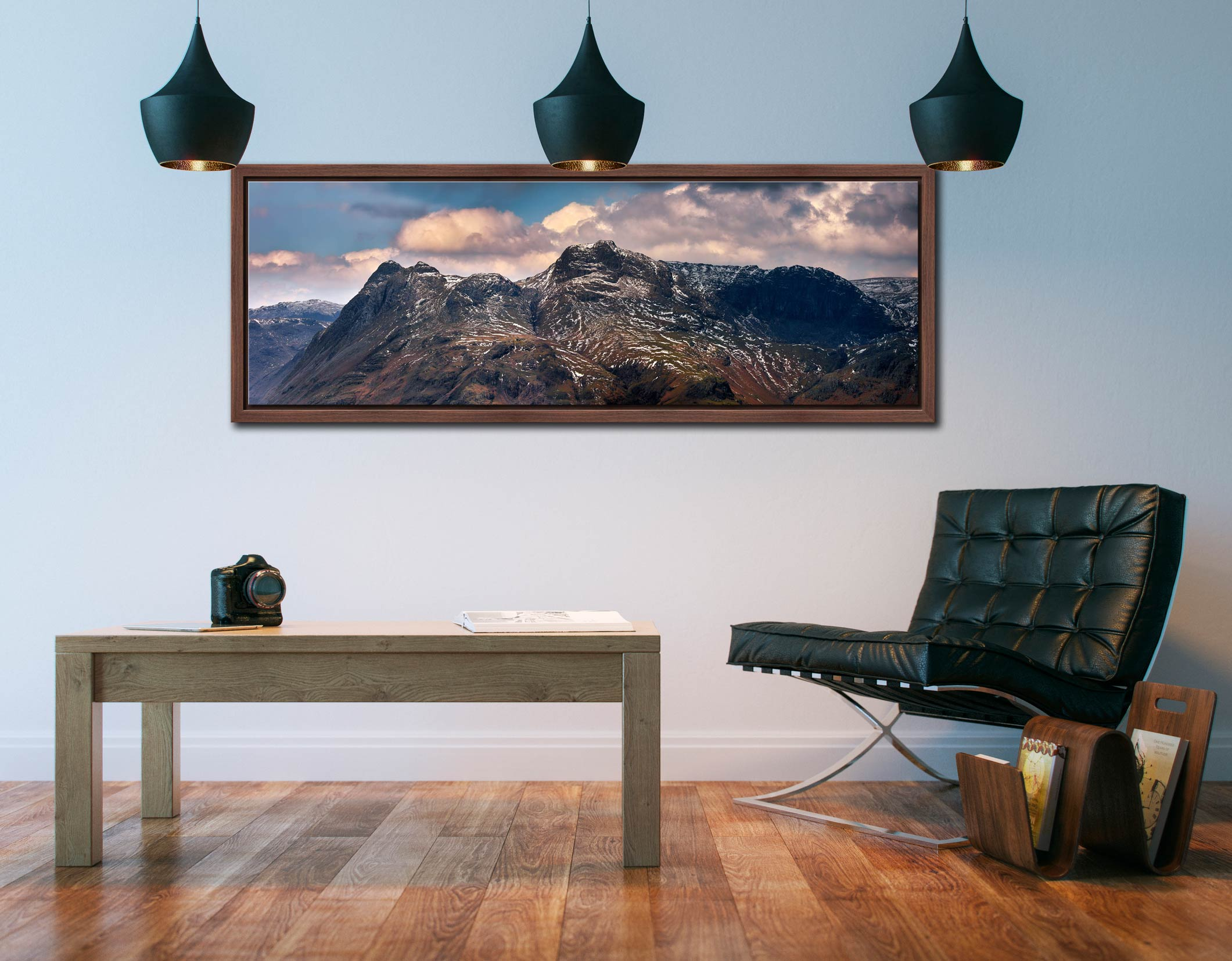 The snowy summits of the Langdale Pike and the dark rock face of Pavey Ark - Walnut floater frame with acrylic glazing on Wall
