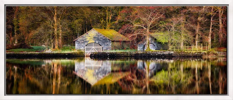 View of the boathouses on a nice, calm spring morning at Coniston Water